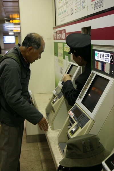 Man coming out of ticket vending machine